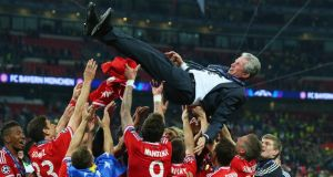Jupp Heynckes of Bayern Munich is thrown skyward by his players after winning the Uefa Champions League final  against Borussia Dortmund at Wembley. Photograph:   Alex Livesey/Getty Images