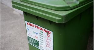 "In the Dublin local authority areas the green bin is seen as the ""free bin"" by most households, except customers of Greyhound, who use bags instead of bins and since last December must pay €9 for six recycling bags. Photograph: Bryan O'Brien"