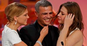 Director Abdellatif Kechiche (centre), and actors Lea Seydoux (left) and Adele Exarchopoulos on stage at the Cannes Film Festival after he received the Palme d'Or award for the film 'La Vie D'Adele'. Photograph: Reuters/Eric Gaillard
