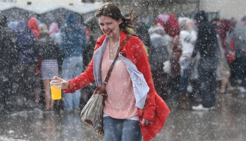It was a choice between holding liquid refreshment or an umbrella. A smart decision made. Photograph: Niall Carson/PA Wire
