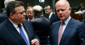Lithuania's foreign minister Linas Linkevicius listens to Britain's foreign secretary William Hague (R) at the start of an European Union foreign ministers meeting in Brussels today. Photograph:  Francois Lenoir/Reuters.