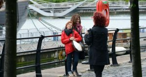 Taking photographs by the river Liffey in Dublin today.Photograph: Eric Luke/The Irish Times