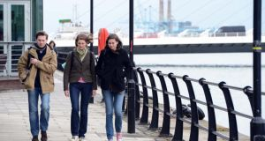 Jackets required: strolling on the North Quay in Dublin city today.Photograph: Eric Luke/The Irish Times