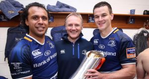 Leinster's Isa Nacewa, head coach Joe Schmidt and Jonathan Sexton celebrate winning the RaboDirect Pro12  Final against Ulster at the weekend . Photograph: Dan Sheridan/Inpho