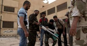 Free Syrian Army fighters prepare to launch a rocket in Deir al-Zor. International estimates put the number of Free Syrian Army fighters and assorted jihadists at about 70,000. Photograph: Reuters/Khalil Ashawi