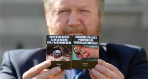 Minister for Health Dr. James Reilly TD with his proposal to introduce standardised/plain packaging of tobacco products, which was approved by the Government. Photographer: Dara Mac Dónaill/The Irish Times  Minister for Health Dr James Reilly pictured earlier this week announcing  his proposal to introduce new packaging for tobacco products without branding. Photographer: Dara Mac Dónaill / THE IRISH TIMES.