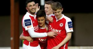 Jake Kelly celebrates with  team-mates after scoring St Patrick's fourth goal.