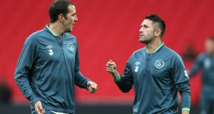 Robbie Keane (right) and John O'Shea talk during a training session at Wembley Stadium