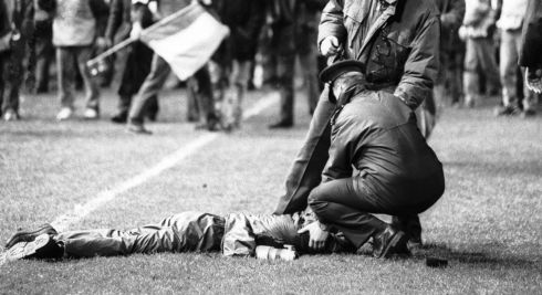A garda attends to an injured person lying on the Lansdowne Road pitch. Photograph: Frank Miller/The Irish Times