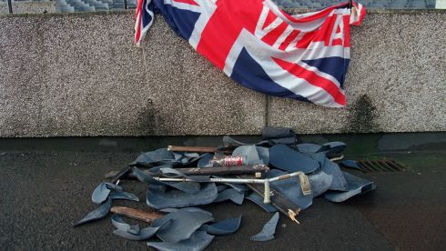 Bits of seating and other missiles used in the riot, under a British supporters' flag. Photograph: Billy Stickland/Inpho
