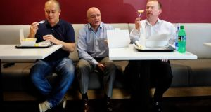 Peter Borza (left), Conor Bofin and Kevin Branigan pictured in P Borza take away in Cornmarket, Dublin, eating fish and chips. Photograph: Aidan Crawley/The Irish Times