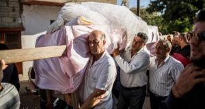 Mourners carry the body of a 17-year-old boy, in Hermel, Lebanon, on Tuesday. The boy was killed in a rocket attack on the village, which is near the Syrian border. Photograph: Bryan Denton/The New York Times