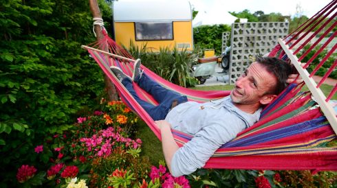 Designer Francis Doyle of Outerscapes takes a breather at his display Past Times - A 70s Retro Garden. Photograph: Bryan O'Brien/The Irish Times