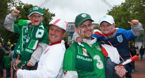 Mixing it up, and proper order: England and Ireland fans enjoy swapping their kids, even for just a moment. Photograph: Scott Heavey/Getty Images