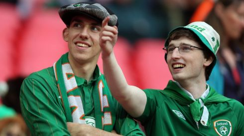 A pair of Irish fans see something funny far away. Maybe it's one of their buddies stuck in amongst all the English crew. Photograph: Donall Farmer/Inpho
