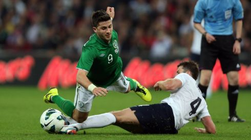 Ireland's Shane Long is tackled by Michael Carrick of England. Photograph: Donall Farmer/Inpho