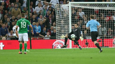 Ireland keeper David Forde saves a shot from England's Alex Oxlade-Chamberlain. Photograph: Donall Farmer/Inpho