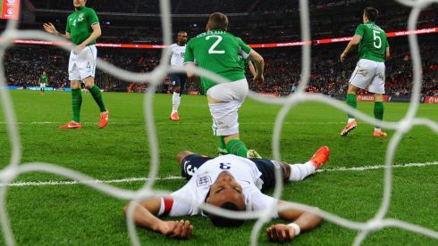 Ashley Cole of England (lying down) rues a missed chance. Photograph: Mike Hewitt/Getty Images