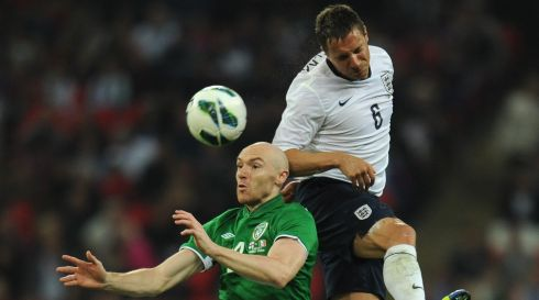 England's Phil Jagielka goes over the head of Connor Sammon. Photograph: Shaun Botterill/Getty Images
