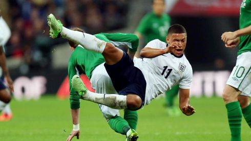 England's Alex Oxlade-Chamberlain in midair after a tackle by Glenn Whelan of Ireland. Photograph: Donall Farmer/Inpho