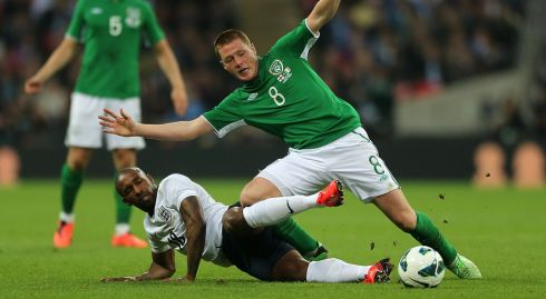 Ireland's James McCarthy and Jermain Defoe make muck fly. Photograph: Nick Potts/PA Wire