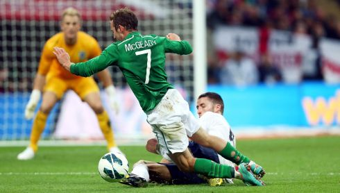 Ireland's Aiden McGeady is brought down by a Gary Cahill challenge. Photograph: Donall Farmer/Inpho