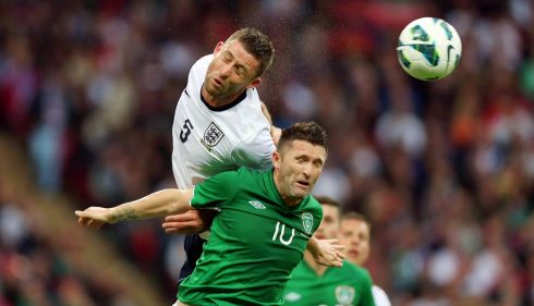 England's Gary Cahill heads clear from Robbie Keane. Photograph: Donall Farmer/Inpho