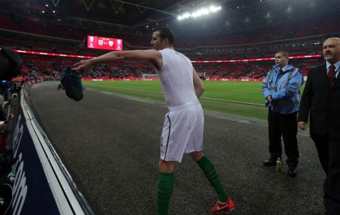 Ireland's John O'Shea gives his jersey to a fan after the game. Photograph: Inpho/Donall Farmer