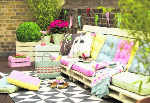 THREE OF THE BEST . . . OUTDOOR INDULGENCES: Set the mood for indulgent Great Gatsby-inspired parties with a louche and laid-back outdoor space. These sunny sorbet-coloured seat pads from Carolyn Donnelly's Eclectic range for Dunnes Stores cost from €20 each. Also in the collection is a black-and-white geometric print rug, €80, and a sunshine throw, €55. Retro-print cushions are €20.