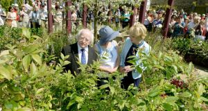 President Michael D Higgins with his wife, Sabina, speak to Jane McCorkell in the Keelings garden at Bloom in the Phoenix Park, Dublin, yesterday. Photograph: David Sleator