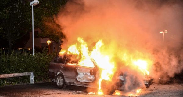 A car set on fire  following riots in the Stockholm suburb of Kista May 21st, 2013. Photograph: Reuters