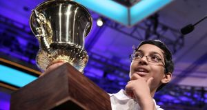Arvind Mahankali holds his trophy after the finals of the 2013 Scripps National Spelling Bee at Gaylord National Resort and Convention Center in National Harbor, Maryland. Photograph: Alex Wong/Getty Images