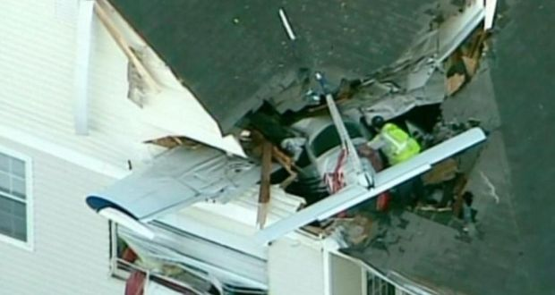 Small plane crashes into US apartment living room