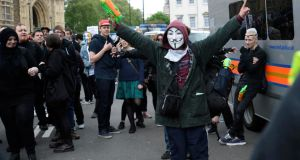 A man gestures while supporting a Unite Against Fascism (UAF) counter-demonstration to another one held by the far-right British National Party (BNP) against the killing of a British soldier, in central London today. Photograph: Dylan Martinez/Reuters