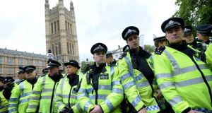 Police officers form a cordon during a demonstration held by the far-right British National Party (BNP)  and a counter-demonstration by Unite Against Fascism (UAF) in central London today.  Photograph: Dylan Martinez/Reuters