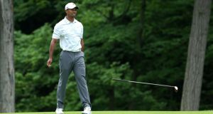 Tiger Woods drops his club after a poor second shot on the par five 15th hole in Ohio. Photograph:  Andy Lyons/Getty Images