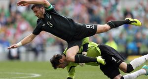 Shane Long is fouled  by Georgia's goalkeeper Giori Loria. Photograph: Donall Farmer/Inpho
