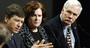 Patty Stonesifer, head of Washingtoncommunity organisation Martha's Table,  flanked by economist Jeffery Sachs  (left) and Ted Turner. Photograph: Stan Honda/AFP/Getty Images