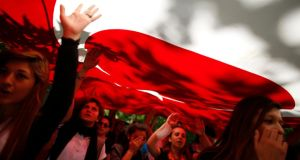 Protesters carry the Turkish flag and shout anti-government slogans during a demonstration at Gezi Park near Taksim Square in central Istanbul  today. Photograph: Stoyan Nenov/Reuters