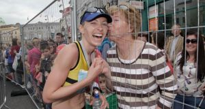 Lizzie Lee pictured kissing her mother Mary Lee of Bishopstown after winning the women's event in the Cork City Half Marathon. Photograph: Clare Keogh