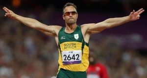 Oscar Pistorius, pictured at a race meeting last September, has kept a low profile since his release on bail a week after the shooting at his Pretoria home in the early hours of February 14th last in which his girlfriend Reeva Steenkamp was killed. Photograph: John Walton/PA Wire
