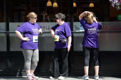 Relaxing before the start of the Flora Women's Mini Marathon in Dublin. Photograph: Dara Mac D'ónaill /The Irish Times         Photographer: Dara Mac Donaill / THE IRISH TIMES