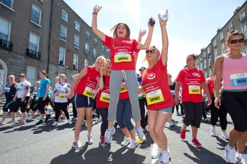 Hearty cheers from women competing in the 2013 Flora Dublin Women's Mini Marathon.   Photograph: Inpho/Morgan Treacy