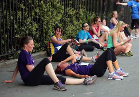 Competitors recovering from their exertions in the 2013 Flora Dublin Women's Mini Marathon on Monday. Photograph: Inpho/Lorraine O'Sullivan
