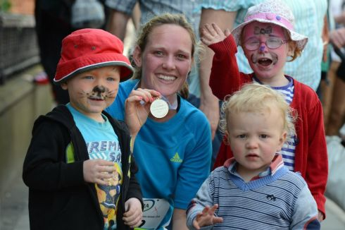 Geraldine Dowd from Dunboyne, Co Meath with her children Caelan, Caoimhe and Tadgh  after she ran   in the  Flora Women's Mini Marathon in Dublin. Photograph: Cyril Byrne/The Irish Times