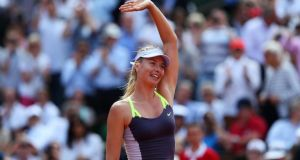 Maria Sharapova waves to the crowd as she celebrates match point  in her quarter-final against Jelena Jankovic at the  French Open  in Paris. Photograph: Clive Brunskill/Getty Images
