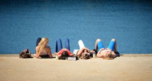 Enjoying the sun on the East Pier in Dunlaoghaire, Dublin yesterday . Photo: David Sleator/THE IRISH TIMES
