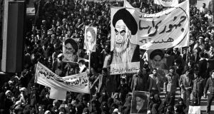 """Air of progress""? Followers of Ayatollah Khomeini march in Tehran during the 1979 revolution in Iran. Photograph: Saris/AP"
