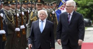 President Michael Higgins, left, reviews Croatian honor guards with his Croatian counterpart Ivo Josipovic, right, in Zagreb, Croatia. President Higgins is on three day official visit to Croatia. Photograph: Damir Sencar/AP Photo