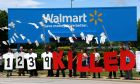 Protesters outside the Wal-Mart Stores  headquarters in Bentonville, Arkansas hold up a sign yesterday commemorating those killed in recent clothing factory tragedies in Bangladesh, including that at the collapsed Rana Plaza.  Photograph: Rick Wilking/Reuters